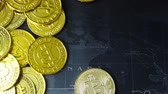international economy : The Gold coin Bitcoin on dark map concept footage.