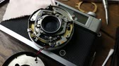 technician : The footage close up hand repair vintage camera film 135 mm.