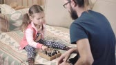 chess board : Little girl learns to play chess