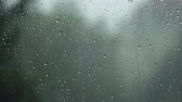 melankoli : Rain pouring down the dark sky, hitting a window