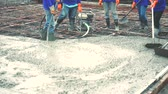 takviye edilmiş : Workers man using a Vibration Machine for eliminate bubbles in concrete. after Pouring ready-mixed concrete on steel reinforcement to make the road by mixing mobile the concrete mixer.