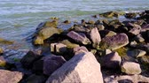 край : Black Sea coast with large stones, waves splashing around on a sunny summer day,