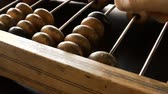 movable : Video shows old wooden abacus. Man is making a calculation Stock Footage