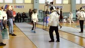 фехтование : DZERZHINSK, RUSSIA - FEBRUARY 28, 2018: Competition in fencing among boys and girls. Sparring two fencers