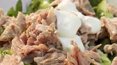 Video shows Meat salad with greens and mayonnaise