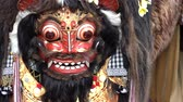 4 in 1 Close up of an animal mask dance during a ritual called Barong in Bali. Considered a native Balinese dance. Represent either ancestral or natural spirits. Footage in normal and slow motion. Wideo