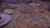 group of people eat pizza at a cafe. close-up children teens eating fast food in cafe , HD