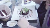 girl eats beet salad with feta and pine nuts on a summer terrace in a cafe, HD Стоковые видеозаписи