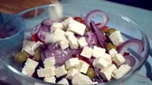 fresh white greek feta cheese falling down into the Greek Salad, HD Стоковые видеозаписи