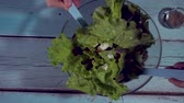 womans hands tossing the a salad. HD, top view, Greek Salad Preparing. Cooking. Healthy Food. Стоковые видеозаписи