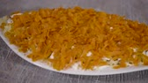 śledź : 4k, close up grated boiled carrots, Preparation of a dish herring under a fur coat. Russian national dish.