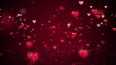 Valentines day abstract background, flying hearts and particles on red. holiday video footage