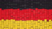 German flag made of cubes moving up and down in a random pattern. 3D animated motion background loop.