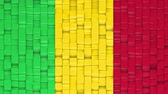 Malian flag made of cubes moving up and down in a random pattern. 3D animated motion background loop.