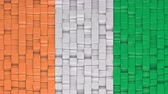Ivorian flag made of cubes moving up and down in a random pattern. 3D animated motion background loop.