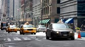 commute : Taxis and other vehicles driving down a typical city street in New York Stock Footage