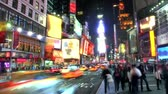 city lights : Time lapse with busy street and sidewalk in Times Square at night, with blurringobscuring of signs and people.