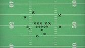 diagrama : Football play being drawn over a graphic of a football field (also available over white background) Stock Footage