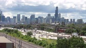 willis tower : The Chicago skyline and the busy Kennedy Expressway traffic from a high angle Stock Footage