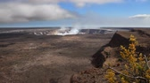 извержение : Wide angle of the crater at Kilauea in Hawaii as steam vents out Стоковые видеозаписи