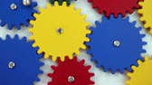 engenharia : A network of coloful gears turning in sync Stock Footage