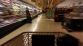 kordé : Time Lapse of shopping cart moving through the aisles of a supermarket with motion blur