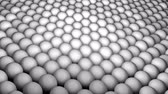 desvanecer : Many abstract spheres, optical Illusion as sea waves, isometric background, modern computer generated 3D render backdrop Stock Footage