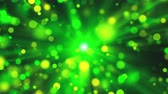 sonhador : Blurred green lights as sun rays and shine particles with bokeh effect, 3d render background, computer generated backdrop Vídeos