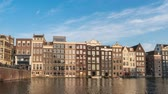 hollanda : Amsterdam city skyline timelapse at Damrak canal waterfront, Amsterdam, Netherlands 4K Time Lapse Stok Video