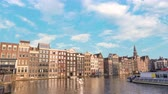 europe holland : Amsterdam city skyline timelapse at canal waterfront, Amsterdam, Netherlands 4K Time Lapse