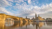 Германия : Dresden city skyline timelapse at Elbe River with Dresden Cathedral and Augustus Bridge, Dresden, Germany 4K Time lapse