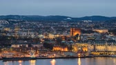 Oslo city skyline day to night timelapse at Oslo City Hall and Harbour, Oslo Norway 4K Time Lapse
