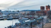 Oslo Norway time lapse 4K, city skyline day to night timelapse at City Hall and harbour