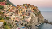 disk : Manalora Italy time lapse 4K, city skyline day to night timelapse at Cinque Terre