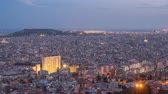 spanyolország : Barcelona Spain time lapse 4K, aerial view city skyline day to night timelapse from Bunkers del Carmel Stock mozgókép