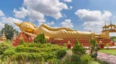 veren : Vientiane Laos time lapse 4K, timelapse at Reclining Buddha statue in Wat Pha That Luang