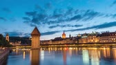 Lucerne (Luzern) Switzerland time lapse 4K, city skyline day to night timelapse at Chapel Bridge