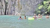 contrastes : MONTANEJOS, SPAIN - JULY 24th 2018: Tourist village of Montanejos. People in the swimming area of ??The bathes spring, on summer vacations. Mountain river with thermal and medicinal waters, in Spain. Stock Footage