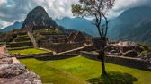 inka : A timelapse view of the ruins of Machu Picchu, with steep Huayna Picchu mountain in the background. Peru, South America