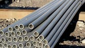corrode : Neatly piled steel pipes and other rusty metal things found in the site. Aside from the new pipes found you can also see that there is a great number of rusty pipes too.  Stock Footage