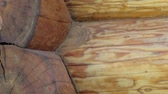 entrar : Close-up view of the corners of the cabin log house tenon. A more close up view and you can see the very core of the log used.  Stock Footage