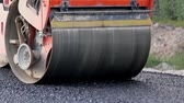 steamroller : Asphalt roller working on the street that was recently repaired. The highway that has been repaired recently has asphalt. A huge heavy equipment compactor or roller compacting the asphalt road. Stock Footage