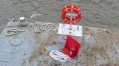 A floating object with safety gears in orange. There are floaters and vest on the floating boat