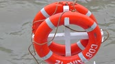 bóia : Two orange round floaters used by lifeguards and crews in a warship