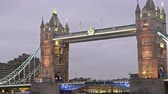 The beauty of the Tower Bridge with lights on. Taken on late afternoon where lights are starting to show on the city