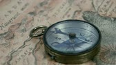finding : A round compass with its pointer moving