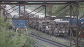 Freight railroad train with bowls of molten metallurgical slag. Stok Video