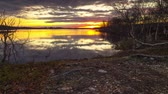 polar regions : Beautiful sunset on forest lake in the tundra Stock Footage