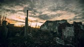 угрюмый : The post-apocalyptic world.Dramatic dawn sky over the walls of a ruined house