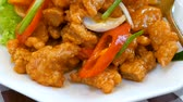 Motion video of Sweet and sour sauce fried with pork on dish in the restaurant (Chinese food) Stok Video